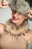 Beauty woman wearing a fur hat and smile Stock Photos