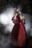 Beauty woman wearing old fashioned dress. Beauty woman wearing old fashioned red dress Stock Photos