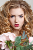 Beauty woman white background hairstyle close up with flower Stock Photography