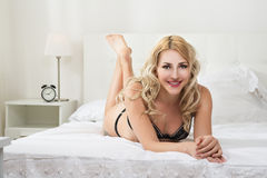 Beauty woman in white bed Stock Photos