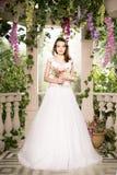 Beauty woman in white dress. Bride, wedding in garden. Brunette Royalty Free Stock Photo