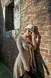 Beauty woman with white hat in a romantic alley Royalty Free Stock Image