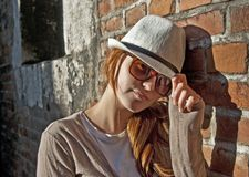 Beauty woman with white hat in a romantic alley Stock Image