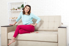 Beauty woman with white perfect smile looking at camera at home Royalty Free Stock Images