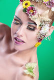 Beauty woman with wild make up looks down Royalty Free Stock Photo