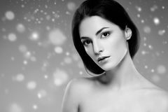 Beauty Woman Winter Snow face Portrait. Beautiful Spa model Girl royalty free stock photography