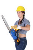Beauty Woman With Chainsaw Royalty Free Stock Images