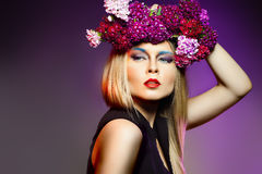 Beauty woman withwith flower wreath. Professional Makeup and hai Stock Images