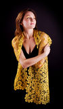 Beauty woman in yellow cape Royalty Free Stock Photo