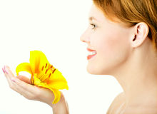 Beauty woman with yellow lily Royalty Free Stock Photography