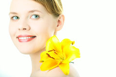 Beauty woman with yellow lily Stock Images