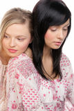 Beauty women. Two young beauty women resting, on white background Stock Photo