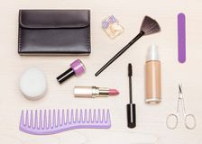 Beauty women essentials on light wood table flat lay Royalty Free Stock Photos