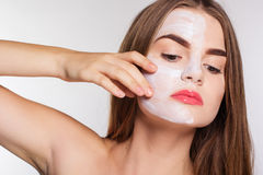 Beauty women getting clay facial mask, spa concept Royalty Free Stock Image
