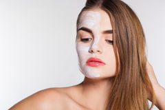 Beauty women getting clay facial mask, spa concept Stock Images