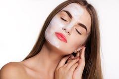 Beauty women getting facial mask, spa concept Royalty Free Stock Photos