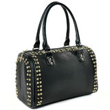Beauty Womens black bag with gold studs on white. Black Bag punk rock style with gold spikes Royalty Free Stock Images