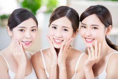 Beauty women smile happily. Three beauty women friend smile happily with health teeth and skin stock images