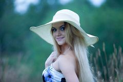 Beauty  women  in a straw hat alone with nature Stock Image