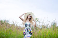 Beauty  women  in a straw hat alone with nature Royalty Free Stock Photography