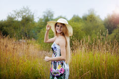 Beauty  women  in a straw hat alone with nature Stock Photo