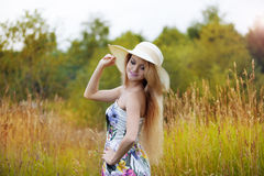 Beauty  women  in a straw hat alone with nature Royalty Free Stock Photo