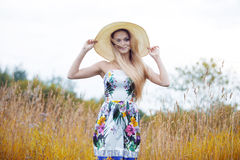 Beauty  women  in a straw hat alone with nature Stock Images