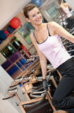 Beauty Working out on the Bike Machine Royalty Free Stock Photography