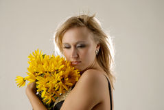 Beauty with yellow flowers. There is women with yellow flowers is looking down royalty free stock photo