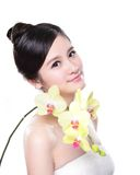 Beauty with yellow orchids Stock Images