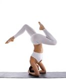 Beauty yoga woman in white stand  on head Stock Photography