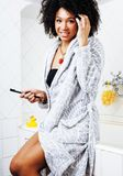Beauty young african american woman in bathrobe with tooth brush. Taking morning care of herself, lifestyle people concept Stock Photography