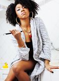 Beauty young african american woman in bathrobe with tooth brush. Taking morning care of herself, lifestyle people concept Stock Photos