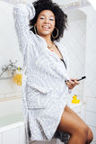 Beauty young african american woman in bathrobe with tooth brush taking morning care of herself, lifestyle concept Stock Images