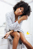 Beauty young african american woman in bathrobe with tooth brush taking morning care of herself, lifestyle concept. Emotional swag Stock Photo
