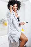 Beauty young african american woman in bathrobe with tooth brush taking morning care of herself, lifestyle concept Stock Photography