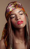 Beauty young afro american woman in shawl on head. Close up Royalty Free Stock Image
