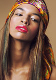 Beauty young afro american woman in shawl on head Stock Photography