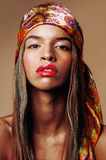 Beauty young afro american woman in shawl on head smiling close up swag Stock Photos