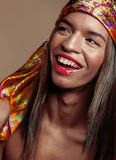 Beauty young afro american woman in shawl on head. Smiling close up swag warm Royalty Free Stock Photos