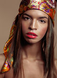 Beauty young afro american woman in shawl on head Royalty Free Stock Images