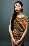 Beauty young asian girl with make up like Pocahontas, red indian Royalty Free Stock Photography