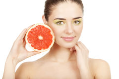 Beauty. Young beautiful woman holding grapefruit Royalty Free Stock Image