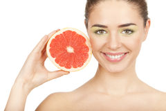 Beauty. Young beautiful woman holding grapefruit Stock Photography