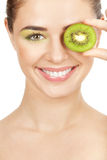 Beauty. Young beautiful woman holding kiwi Royalty Free Stock Photo