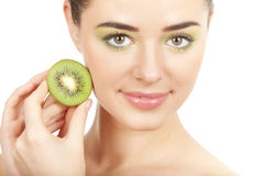 Beauty. Young beautiful woman holding kiwi Royalty Free Stock Image