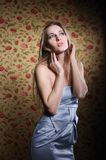 Beauty young blond girl in silver dress Royalty Free Stock Photography