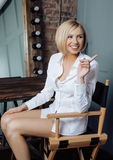 Beauty young blond real woman in white shirt at home smiling friendly like Hollywood star is preparing for the show Stock Images
