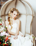 Beauty young blond woman bride alone in luxury vintage interior with a lot of flowers Stock Images