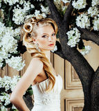 Beauty young blond woman bride alone in luxury vintage interior with a lot of flowers. Close up Royalty Free Stock Images